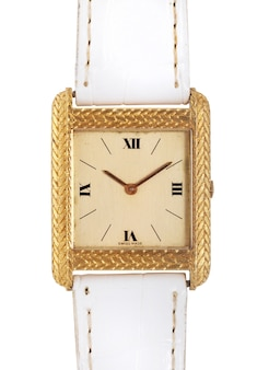 Gold watch with a white leather band under the lights isolated on a white