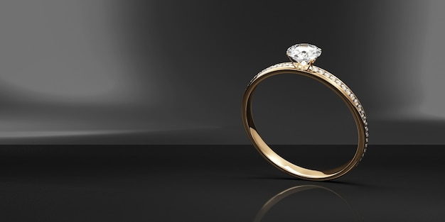 黒のスタジオの背景にダイヤモンドとゴールドの結婚指輪
