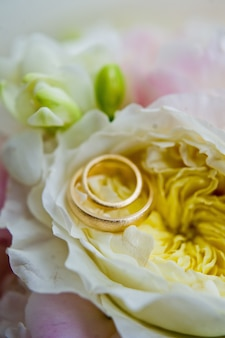 Gold wedding rings for the bride and groom.