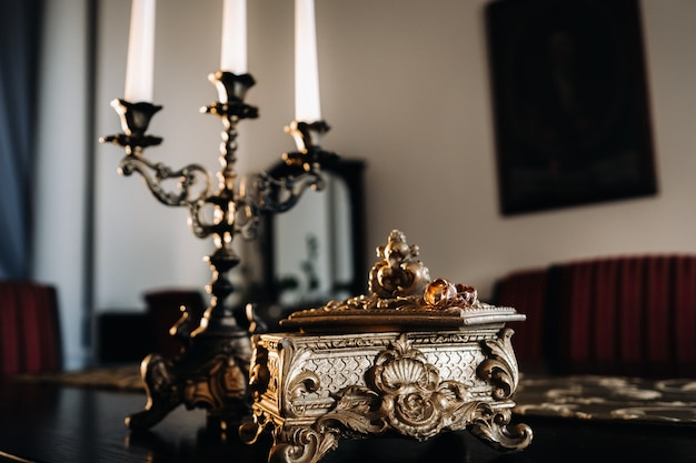 Gold wedding rings lie on an antique jewelry box. wedding rings for ceremonies.