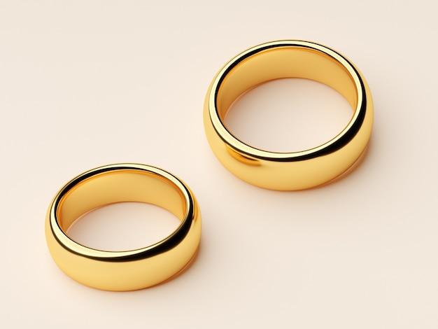 금 결혼 반지가 나란히 놓여 있습니다.