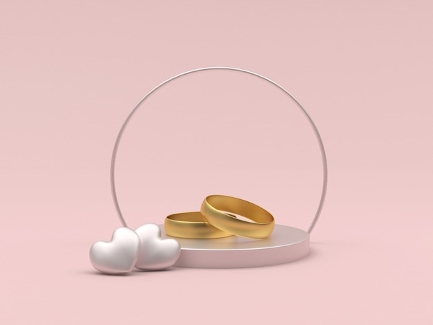 Gold wedding rings and two hearts on a round stand