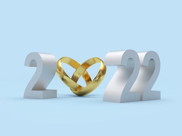 새해의 은색 숫자가 있는 금 결혼 반지