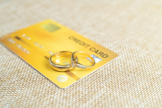 Gold wedding rings with credit cards pay the cost by credit card