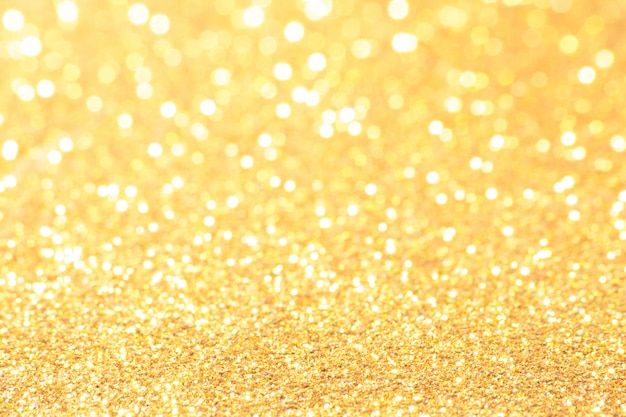 Gold and white bokeh lights defocused. abstract background