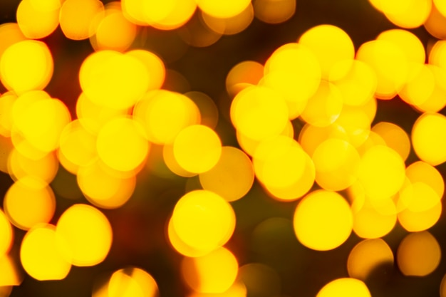 Gold yellow abstract background with bokeh defocused blurred lights