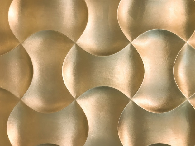 Golden 3d interior decorative wall panel with unusual geometric shape.