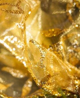 大晦日クリスマスと幸せな休日のための黄金の抽象的なぼかしの焦点がぼけた背景の概念