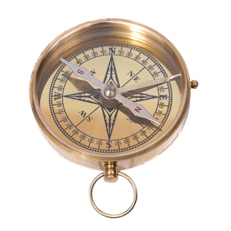 Golden ancient compass isolated on white background