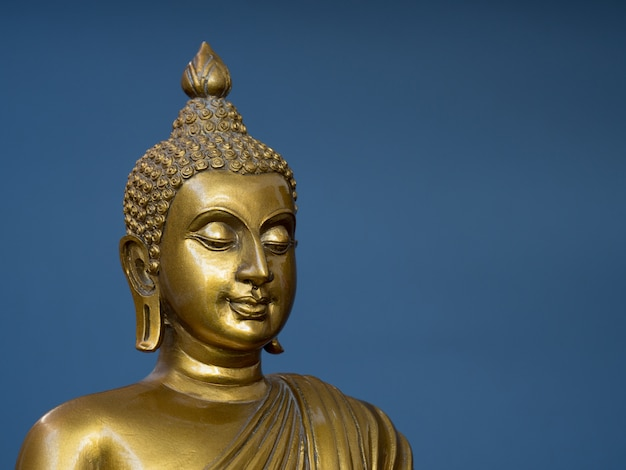 Golden antique buddha statue.