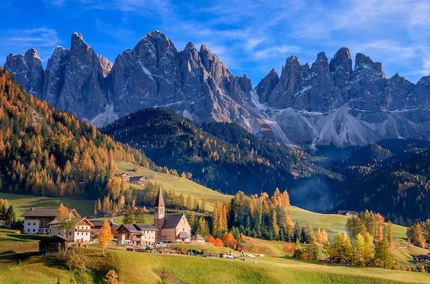 Golden autumn in val di funes valley and chapel santa maddalena.  odle mountain group. dolomite's mountains, italy