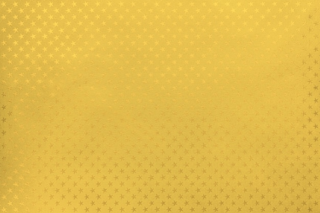Golden background from metal foil paper with a stars pattern