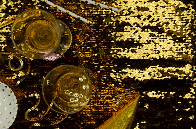 Golden background with champagne glasses top view