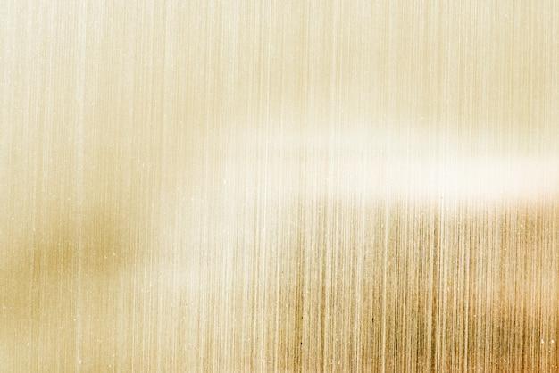 白のストライプの壁紙と金色の背景