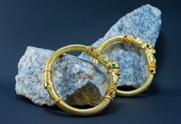 Golden bangles on a stone