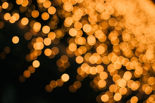 Golden beautiful bokeh on a black background.