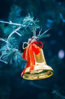 Golden bell on chrismas tree.