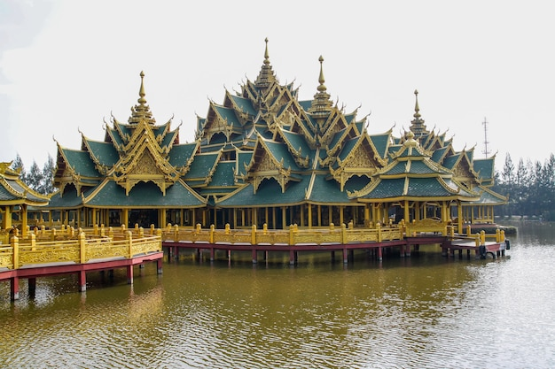 The golden big pavilion on water in asia