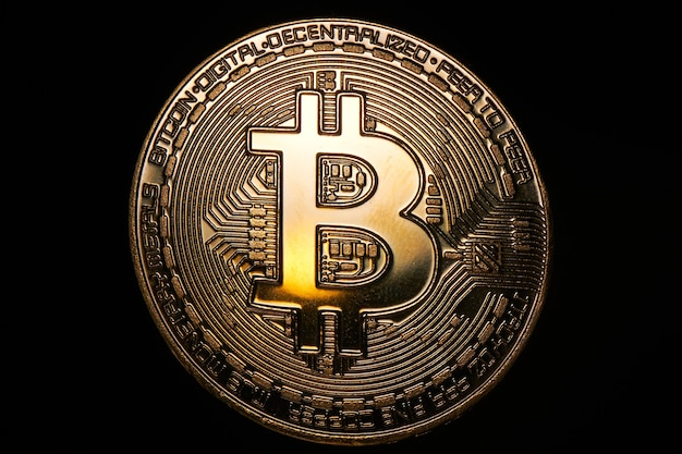 Golden bitcoin on a black background