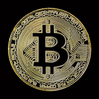 Golden bitcoin on black surface