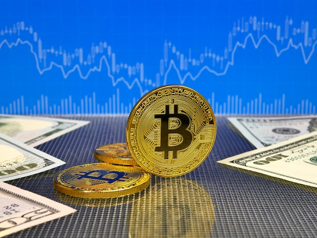 Golden bitcoin on blue abstract finance .