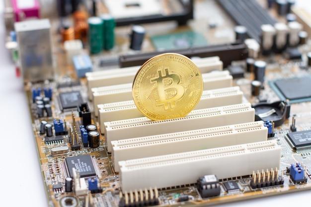 Golden bitcoin on the circuit board