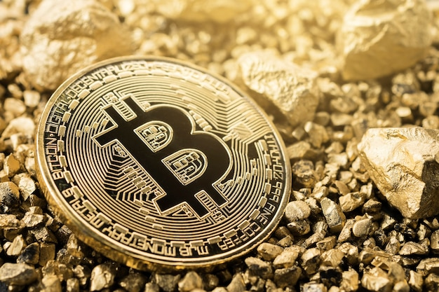 Golden bitcoin coin and mound of gold. bitcoin cryptocurrency.