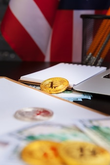 Golden bitcoin coin on us dollars close up. electronic crypto currency