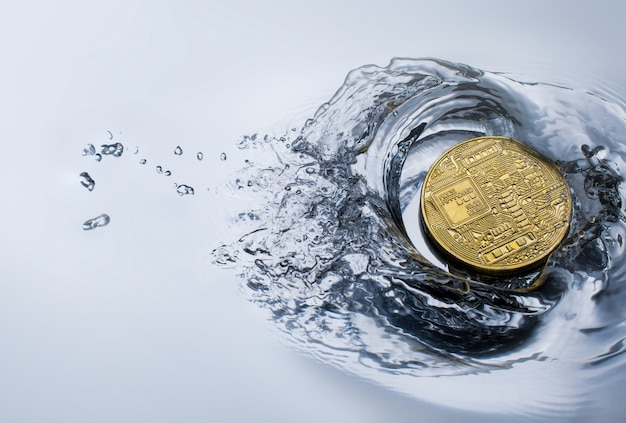 Golden bitcoin coin with water splash crypto currency concept.