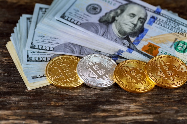 Golden bitcoin coins on a paper dollars money virtual currency.
