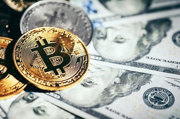 Golden bitcoin coins on a paper dollars money