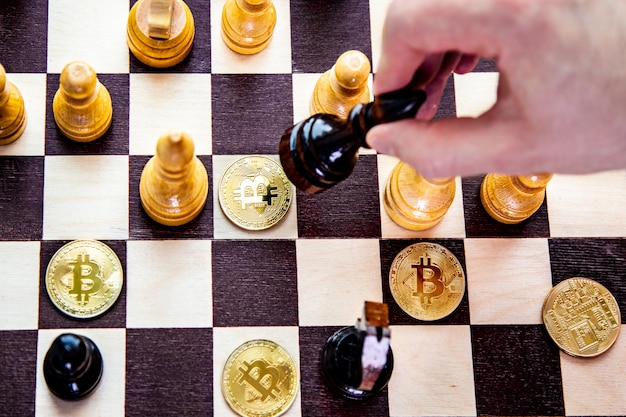 Golden bitcoin coins symbolizes elements of crypto currency with chess board