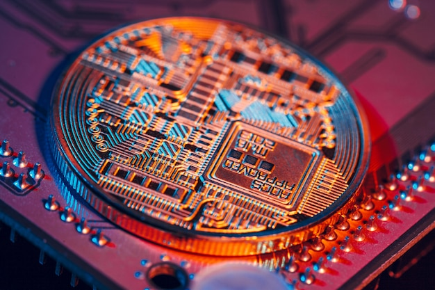 Golden bitcoin and computer chip in