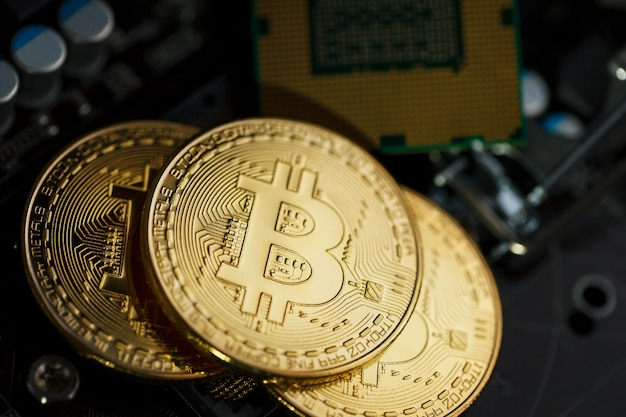 Golden bitcoin cryptocurrency on computer circuit board cpu