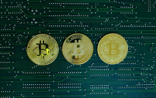 Golden bitcoin cryptocurrency old and new version on computer electronic circuit board background