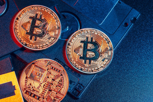 Golden bitcoin on floppy disk