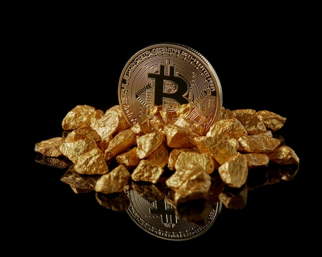 Golden bitcoin and gold lumps as world trends both isolated with reflective surface. digital virtual currency electronic money mining blockchain exchange innovation business