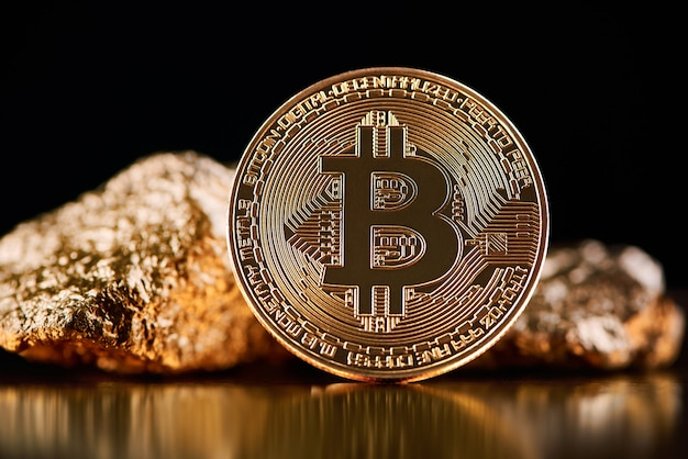 Golden bitcoin next to gold lumps