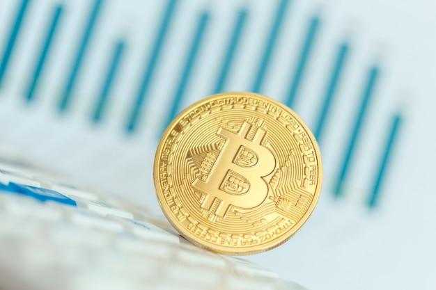 Golden bitcoin physical coin symbol on keyboard