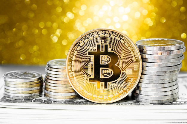 Golden bitcoin with money coin on backdrop golden light background. finance concept.