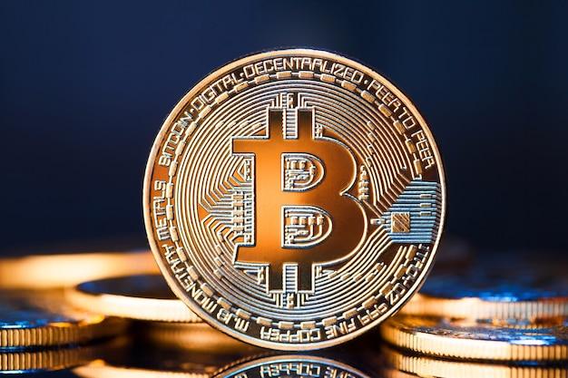 Golden bitcoins on blue surface