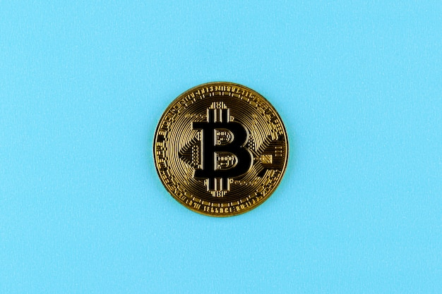 Golden bitcoins on blue
