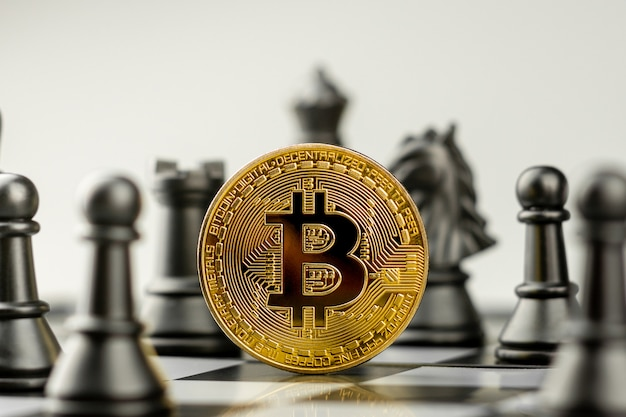 Golden bitcoins on chess board. - winner of a business and economy concept.