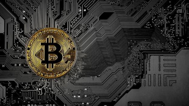 Golden bitcoins on circuit board.