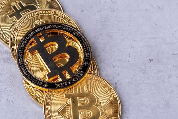 Golden bitcoins on a concrete background, closeup photo
