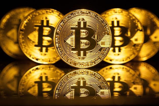 Golden bitcoins on dark surface