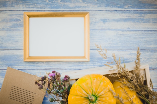 Golden blank frame with autumn pumpkins