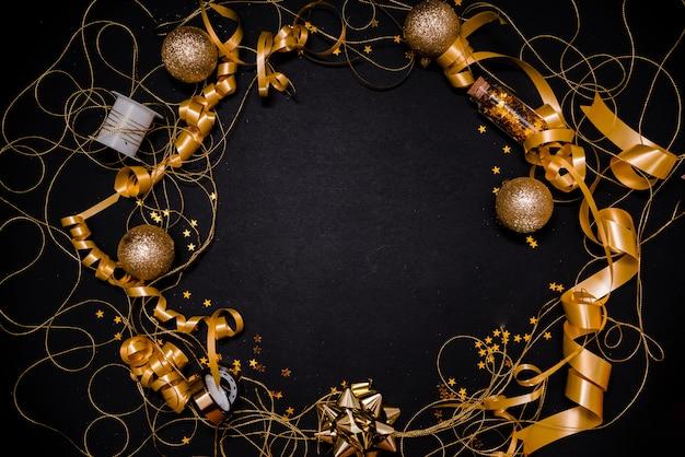 Golden bow on black background