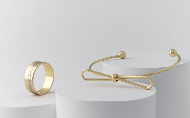 Golden bow shape bracelet and triple ring on white cylinders with copy space