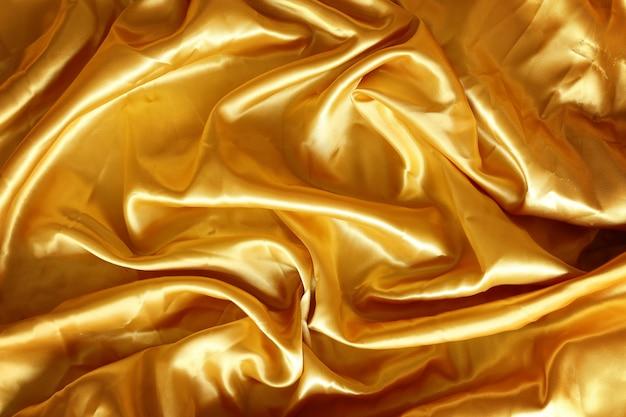 Золотисто-коричневая ткань шелк для фона